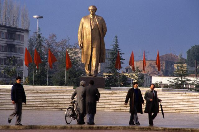 ca. 1988, Tirane, Albania --- In celebration of Enver Hoxha's 100th birthday, a statue was erected in Tirane's main square. --- Image by © Michel Setboun/Corbis