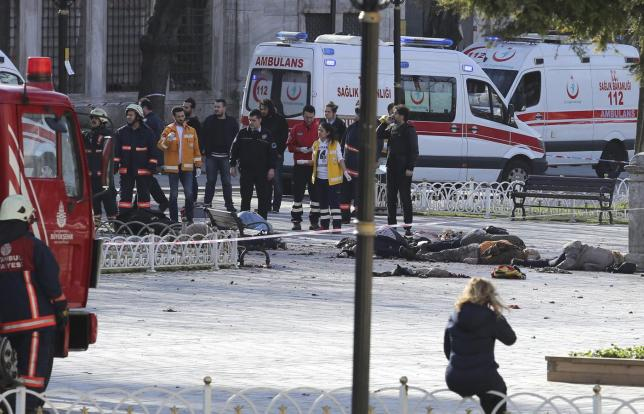 Rescue teams gather at the scene after an explosion in central Istanbul, Turkey January 12, 2016. REUTERS/Kemal Aslan